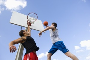 Man Attempting to Score in Basketball Game